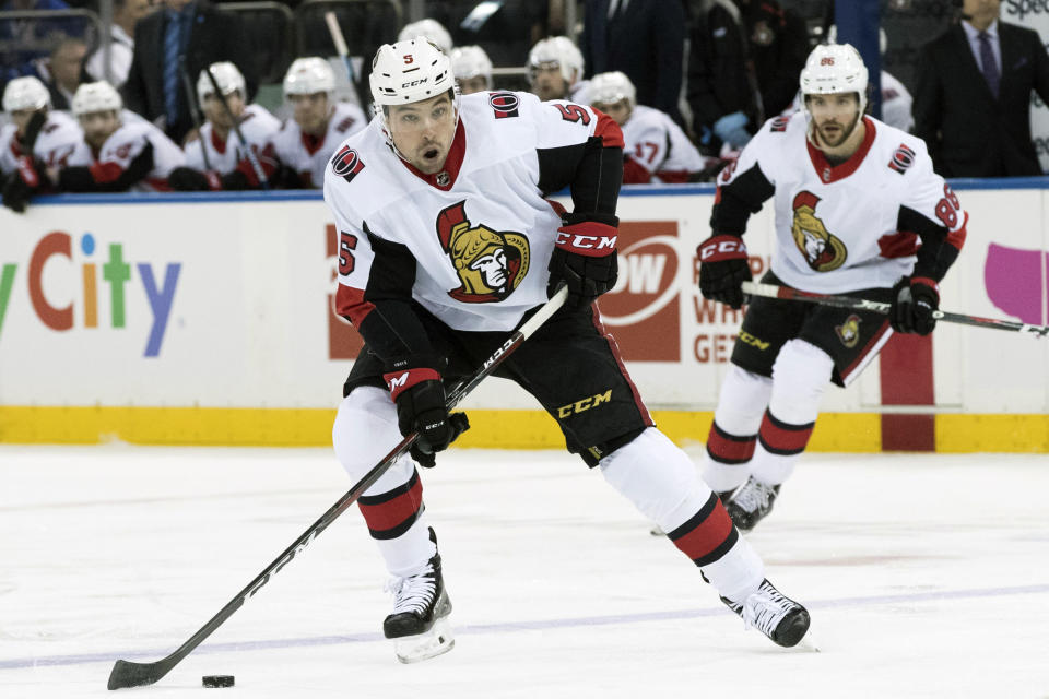 FILE - In this April 3, 2019, file photo, Ottawa Senators defenseman Cody Ceci (5) controls the puck during the first period of an NHL hockey game against the New York Rangers, at Madison Square Garden in New York. The Toronto Maple Leafs acquired defenseman Cody Ceci, a 2020 third-round pick and minor leaguers Ben Harpur and Aaron Luchuk from the Ottawa Senators for defenseman Nikita Zaitsev, forward Connor Brown and minor leaguer Michael Carcone. The teams announced the trade early on Monday, July 1, 2019, roughly three and a half hours before the start of free agency. (AP Photo/Mary Altaffer, File)