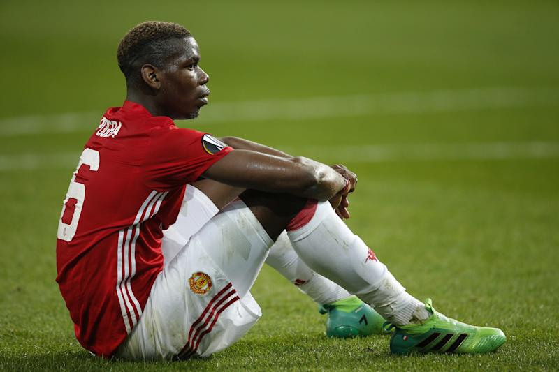 Paul Pogba sits frustrated on the pitch