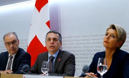 Swiss Economic Minister Parmelin and Swiss Justice Minister Keller-Sutter sit beside as Swiss Foreign Minister Cassis addresses a news conference in Bern