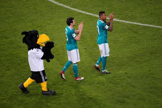 Soccer Football - International Friendly - Germany vs Spain - ESPRIT arena, Dusseldorf, Germany - March 23, 2018 Germany's Jerome Boateng, Mats Hummels and the mascot applaud their fans after the match REUTERS/Wolfgang Rattay