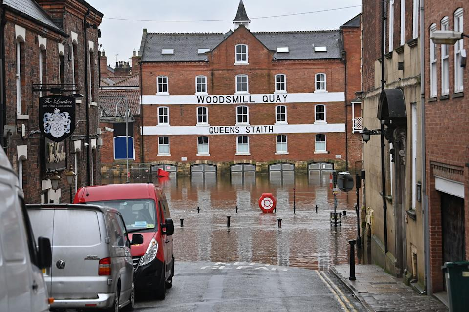 Flood waters are seen in a street in York, northern England, on January 19, 2021 as Storm Christoph brings heavy rains across England. (Photo by Paul ELLIS / AFP) (Photo by PAUL ELLIS/AFP via Getty Images)