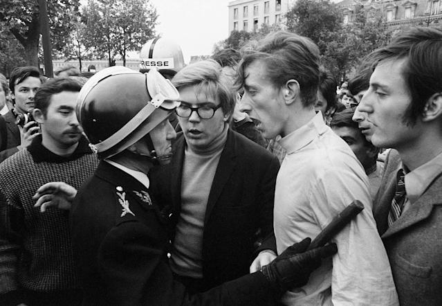 <p>On the Quai d'Orsay at the Pont des Invalides, students come face-to-face with a baton-wielding riot policeman in Paris on May 7, 1968. (Photo: Gökşin Sipahioğlu/SIPA) </p>
