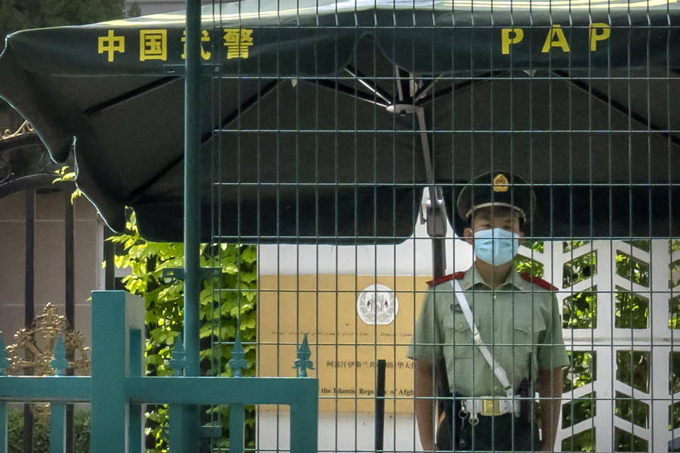 A Chinese paramilitary policeman stands guard outside the Afghanistan Embassy in Beijing, on Aug. 20, 2021. In the U.S. departure from Afghanistan, China has seen the realization of long-held hopes for a reduction of the influence of a geopolitical rival in what it considers its backyard. Yet, it is also deeply concerned that the very withdrawal could bring instability to that backyard - Central Asia - and possibly even spill over the border into China itself in its heavily Muslim northwestern region of Xinjiang. (AP Photo/Mark Schiefelbein)