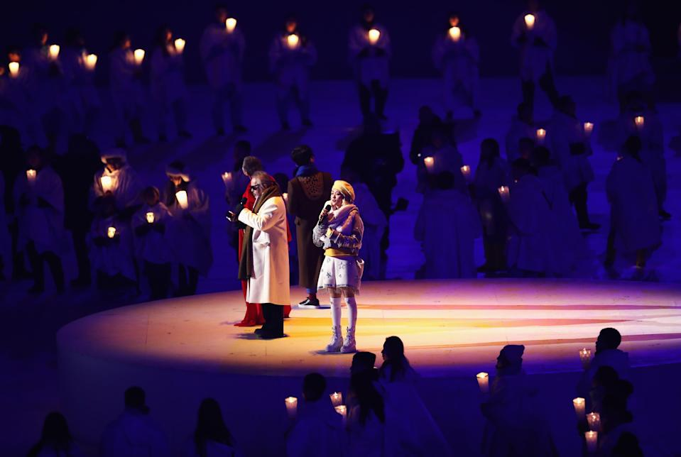 <p>Singers perform during the Opening Ceremony of the PyeongChang 2018 Winter Olympic Games at PyeongChang Olympic Stadium on February 9, 2018 in Pyeongchang-gun, South Korea. (Photo by Ronald Martinez/Getty Images) </p>
