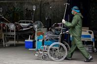 Due to to the nursing shortfall, some facilities have had to slash their bed capacity (AFP/Maria TAN)