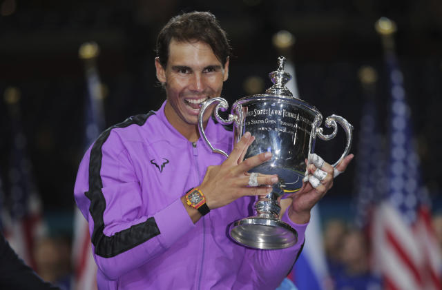 FILE - In this Sept. 8, 2019, file photo, Rafael Nadal, of Spain, poses with the championship trophy after defeating Daniil Medvedev, of Russia, to win the men's singles final of the U.S. Open tennis championships in New York. New York Gov. Andrew Cuomo said Tuesday, June 16, 2020, that the U.S. Open tennis tournament will held starting in late August as part of the state's reopening from shutdowns caused by the coronavirus pandemic.(AP Photo/Charles Krupa)