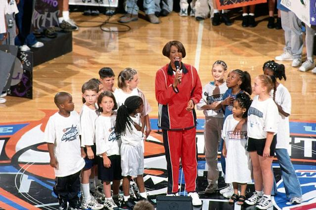 NEW YORK - JULY 14: Singer Whitney Houston performs the national anthem at the 1999 WNBA All-Star Game played July 14, 1999 at Madison Square Garden in New York, New York. NOTE TO USER: User expressly acknowledges that, by downloading and or using this photograph, User is consenting to the terms and conditions of the Getty Images License agreement. Mandatory Copyright Notice: Copyright 1999 NBAE (Photo by Lou Capozzola/NBAE via Getty Images)