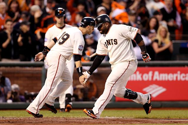 SAN FRANCISCO, CA - OCTOBER 24: Pablo Sandoval #48 of the San Francisco Giants celebrates with teammate Marco Scutaro #19 after scoring a two run home run to left field against Justin Verlander #35 of the Detroit Tigers in the third inning during Game One of the Major League Baseball World Series at AT&T Park on October 24, 2012 in San Francisco, California. (Photo by Christian Petersen/Getty Images)