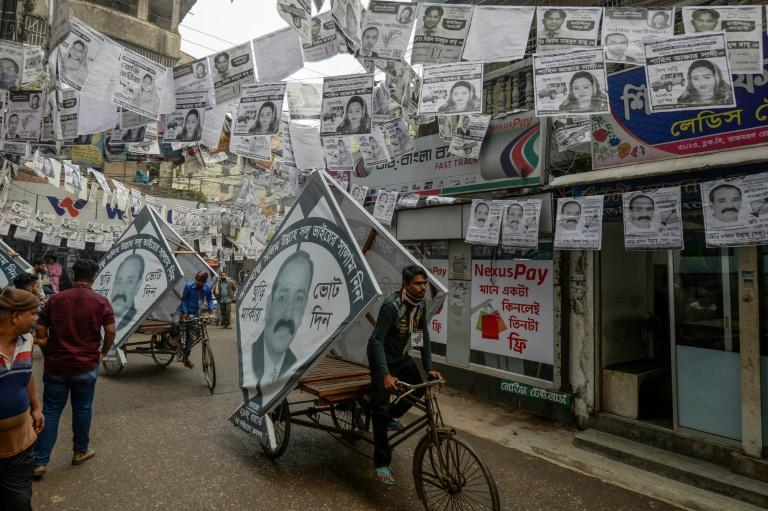 Dhaka is awash with millions of plastic-laminated campaign posters ahead of elections (AFP Photo/Munir UZ ZAMAN)