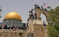 Palestinians gather at Jerusalem's Al-Aqsa mosque compound, the third holiest site of Islam