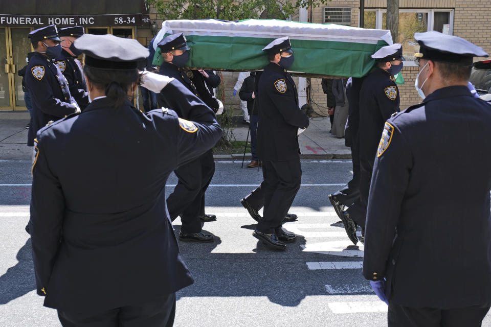 Masks, gloves, tears as NYPD mourns commander lost to virus