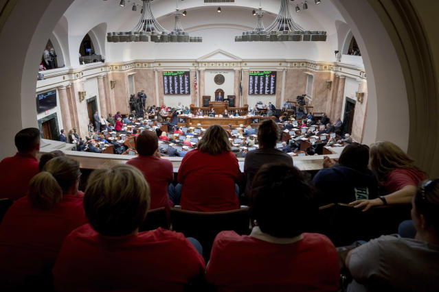 <p>Teachers from across Kentucky fill the gallery of the House chamber in the state Capitol to rally for increased funding and to protest changes to their state funded pension system, Friday, April 13, 2018, in Frankfort, Ky. (Photo: Bryan Woolston/AP) </p>