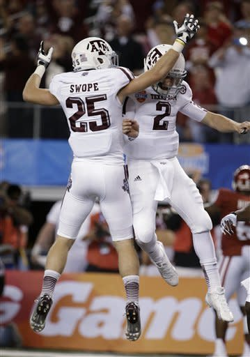 Texas A&M's Ryan Swope (25) and Johnny Manziel (2) celebrate a touchdown run by Manziel against Oklahoma in the first half of the Cotton Bowl NCAA college football game Friday, Jan. 4, 2013, in Arlington, Texas. (AP Photo/Tony Gutierrez)