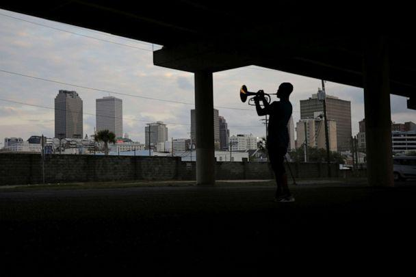 PHOTO: Lloyd Robinson, a local musician plays a marching mellophone under a highway during a gathering with musicians friends as the spread of coronavirus disease (COVID-19) continues, in New Orleans, April 6, 2020. (Carlos Barria/Reuters)