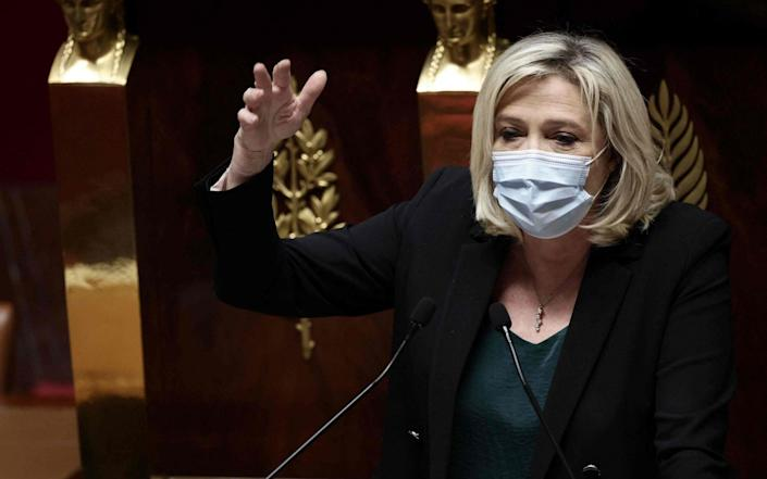 """Head of the """"Rassemblement national"""" far-right party Marine Le Pen addresses MPs - THOMAS COEX/AFP"""