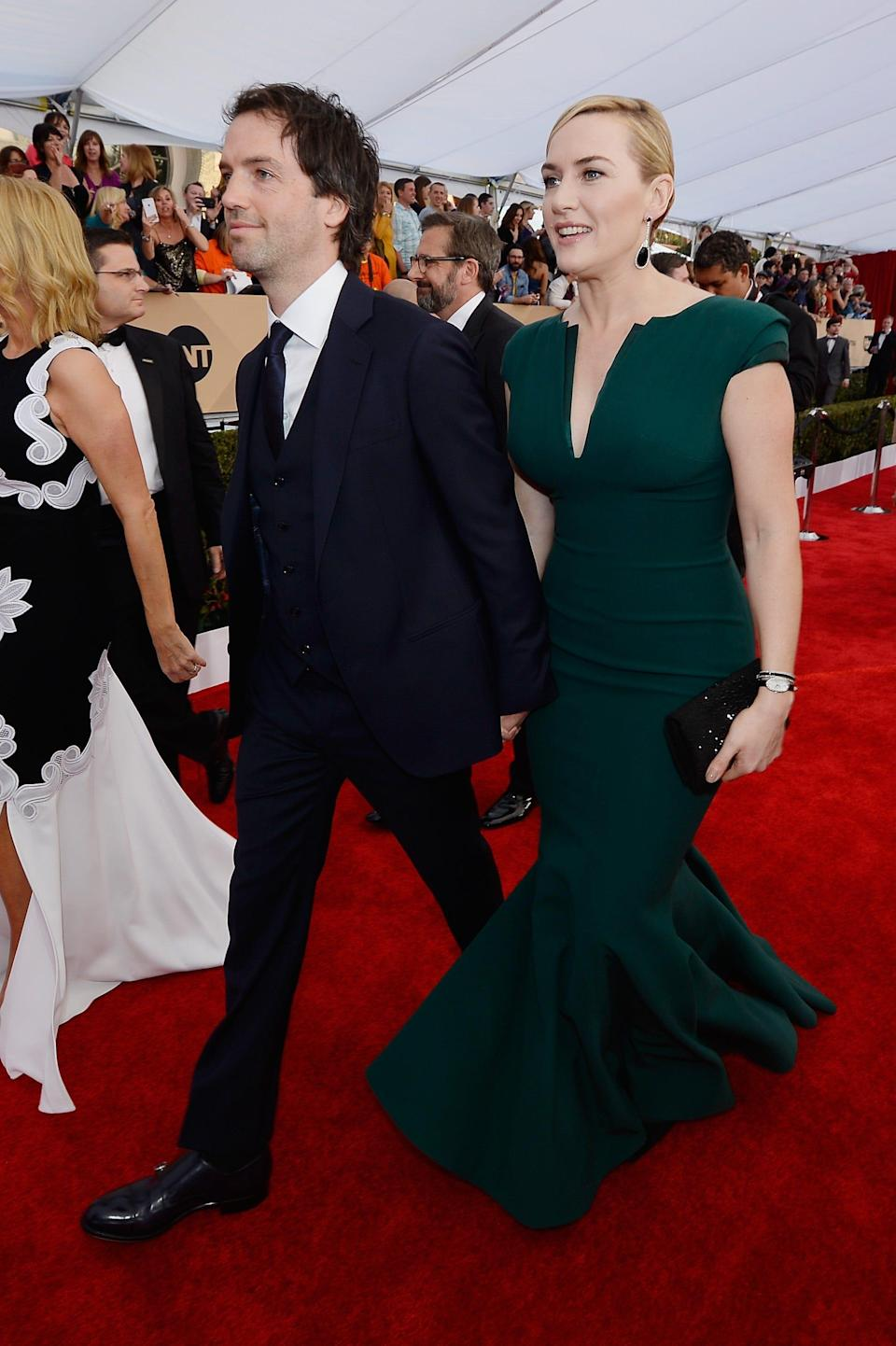 Kate Winslet, right, and third husband Edward Abel Smith (formerly known as Ned Rocknroll) walk the Screen Actors Guild Awards red carpet in 2016. The couple married in 2012.