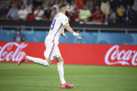 France's Karim Benzema celebrates after scoring his side's first goal from the penalty spot during the Euro 2020 soccer championship group F match between Portugal and France at the Puskas Arena in Budapest, Wednesday, June 23, 2021. (Franck Fife, Pool photo via AP)