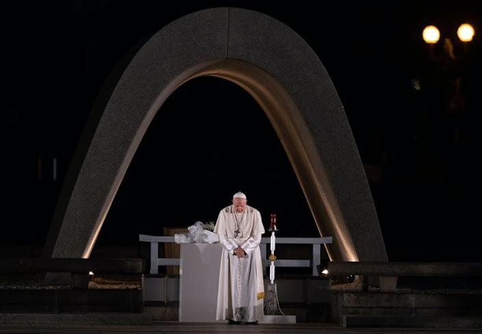 "<span class=""caption"">Pope Francis observes a minute of silence for the victims of Hiroshima at the city's Peace Memorial Park.</span> <span class=""attribution""><a class=""link rapid-noclick-resp"" href=""https://www.gettyimages.com/detail/news-photo/pope-francis-stands-next-to-the-memorial-cenotaph-as-he-news-photo/1184309609?adppopup=true"" rel=""nofollow noopener"" target=""_blank"" data-ylk=""slk:Carl Court/Getty Images"">Carl Court/Getty Images</a></span>"