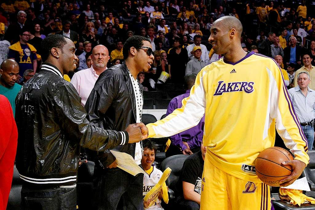"""The hip hop stars also got to schmooze with Kobe Bryant, who was feeling a little under the weather, but insisted that his sore throat had nothing to do with the Lakers' loss: 100-92. Noel Vasquez/<a href=""""http://www.gettyimages.com/"""" target=""""new"""">GettyImages.com</a> - May 4, 2009"""