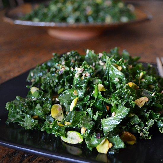 """<p>Andrew Zimmern breaks from the standard kale salad by adding pistachios and sesame seeds for rich nuttiness and a bright, vinegary miso dressing.</p><p><a href=""""https://www.foodandwine.com/recipes/kale-salad-with-miso-and-pistachios"""">GO TO RECIPE</a></p>"""