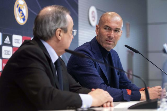 Zinedine Zidane looks at President of Real Madrid, Florentino Perez, left, during a press conference in Madrid, Spain, Thursday, May 31, 2018. Zidane quit as Real Madrid coach on Thursday, less than a week after leading the team to its third straight Champions League title, saying the club needed a change in command. (AP Photo/Borja B. Hojas)