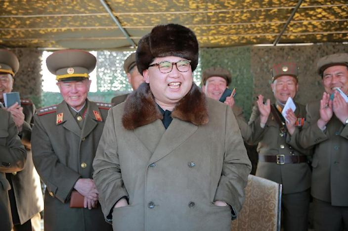 North Korean leader Kim Jong-Un (C) inspects a rocket launching system at an undisclosed location (AFP Photo/-)