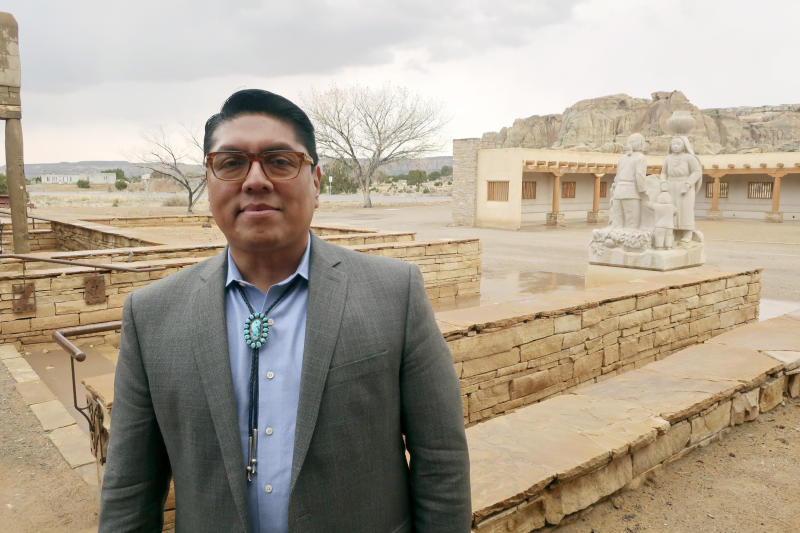 """FILE - In this March 21, 2019 file photo, Acoma Pueblo Gov. Brian Vallo poses outside the Pueblo's cultural center about 60 miles west of Albuquerque, New Mexico. A ceremonial shield at the center of a yearslong international debate over exporting of sacred Native American objects to foreign markets has returned to New Mexico. U.S. and Acoma Pueblo officials planned Monday, Nov. 18 to announce the shield's return from Paris, where it had been listed for bidding in 2016 before the EVE auction house took the rare step of halting its sale. """"It will be a day of high emotion and thanksgiving,"""" Vallo said ahead of the shield's expected return to his tribe.  (AP Photo/Felicia Fonseca, File)"""
