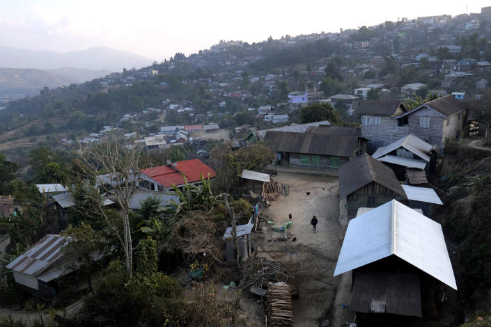 A girl walks in the courtyard of her house, just below the house of Shimray Wungreichon, 43, who works as a nurse in a government hospital in Ukhrul, in the northeastern Indian state of Manipur, Friday, Jan. 15, 2021. This little mountain town has a single 100-bedded government hospital that caters to 180,000 people of the entire district. (AP Photo/Yirmiyan Arthur)