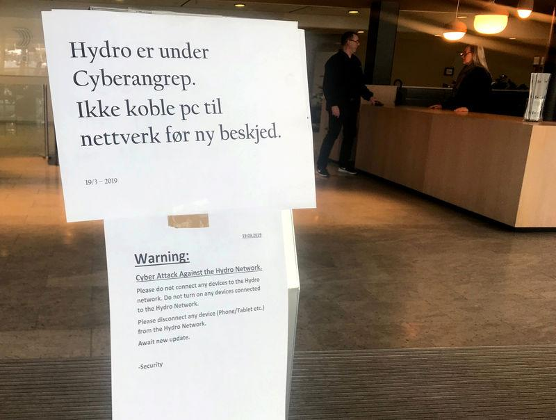 A sign warning employees not to connect devices to the network in the wake of a cyber attack is seen at the headquarters of aluminum producer Norsk Hydro in Oslo