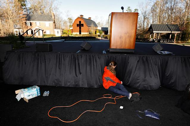 <p>A worker prepares the stage near the Billy Graham Library before the start of the funeral for evangelist Billy Graham in Charlotte, N.C., March 2, 2018. (Photo: Jonathan Drake/Reuters) </p>