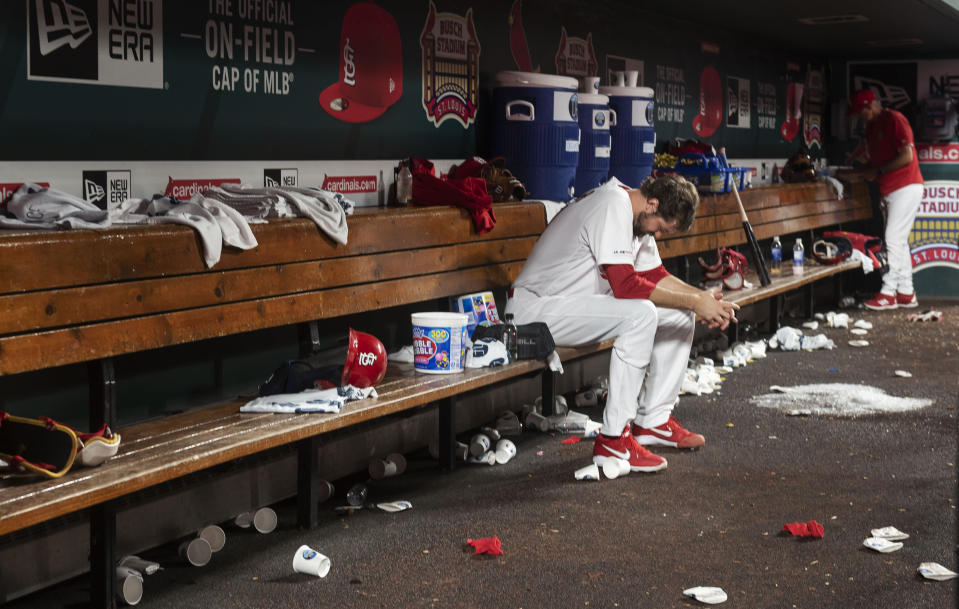 St. Louis Cardinals pitcher Andrew Miller sits on the bench after the team's 7-6 loss to the Miami Marlins in 11 innings in a baseball game Thursday, June 20, 2019, in St. Louis. (AP Photo/L.G. Patterson)