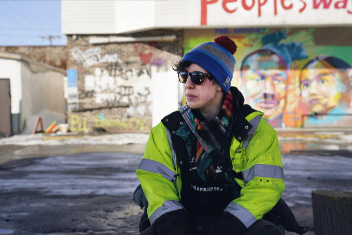 Madi Ramirez-Tentinger, a lead organizer for activism, waits to be interviewed on Feb. 24, 2021, at George Floyd Square in Minneapolis. Ten months after police officers brushed off George Floyd's moans for help on the street outside a south Minneapolis grocery, the square remains a makeshift memorial for Floyd who died at the hand of police making an arrest. The trial of former Minneapolis police officer Derek Chauvin, one of the four officers, will begin with jury selection on March 8. (AP Photo/Jim Mone)