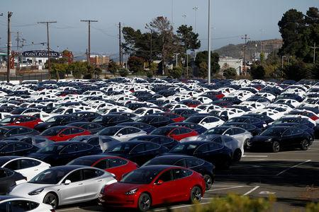 FILE PHOTO: A parking lot of predominantly new Tesla Model 3 electric vehicles is seen in Richmond, California, U.S. June 22, 2018. REUTERS/Stephen Lam