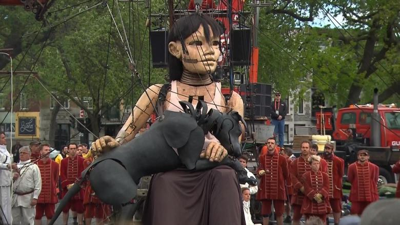 Marionettes as tall as houses march along Montreal streets during 375th birthday bash