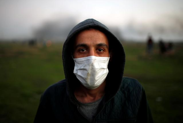 """<p>A protester wearing a medical mask poses for a photograph at the scene of clashes with Israeli troops near the border with Israel, east of Gaza City, Jan. 12, 2018. """"The world must understand that unemployment is driving us all towards becoming fighters. We are not going to fight Hamas or Fatah, we will fight the Jews only. We have taken part in rallies demanding Hamas and Fatah end their division and calling for more electricity but we are not going to the streets to throw stones at Hamas or at the Palestinian Authority,"""" he said. (Photo: Mohammed Salem/Reuters) </p>"""