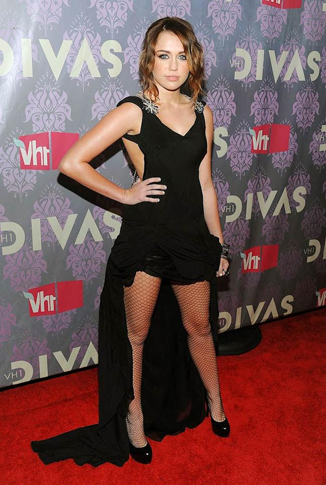 "The dress Miley wore to VH1 Divas was business in the front and party in the back, just like her father's famous hairstyle: the mullet. Dimitrios Kambouris/<a href=""http://www.wireimage.com"" target=""new"">WireImage.com</a> - September 17, 2009"