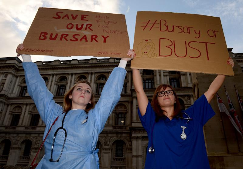 Student midwives and nurses stage a protest over the scrapping of bursaries outside the Department of Health in London.