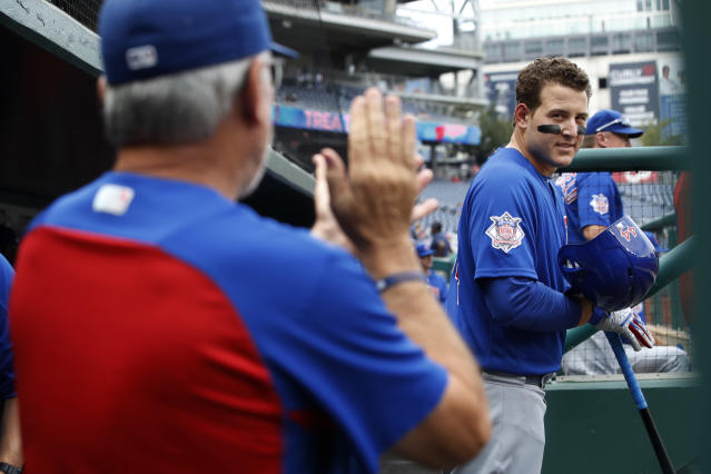 Chicago Cubs first baseman Anthony Rizzo (44) looks at manager Joe Maddon, left, as Maddon claps for the team at the start of a baseball game against the Washington Nationals, Thursday, Sept. 13, 2018, at Nationals Park in Washington. (AP Photo/Jacquelyn Martin)