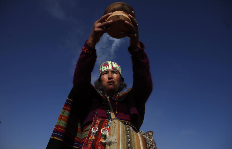 An Aymaran spiritual guide burns incense during the wedding ceremony of Bolivia's Vice President Alvaro Garcia Linera and Claudia Fernandez at a temple of stone walls in Tiwanaku, Bolivia, Saturday, Sept. 8, 2012. The ceremony uniting the 49-year-old vice president with the 25-year-old journalist was held at an ancestral site constructed by the ancient Aymara people some 3,000 years ago to observe the heavens. (AP Photo/Juan Karita)