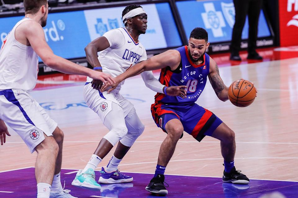 Pistons guard Cory Joseph dribbles against Clippers guard Reggie Jackson during the first half at Little Caesars Arena, April 14, 2021.