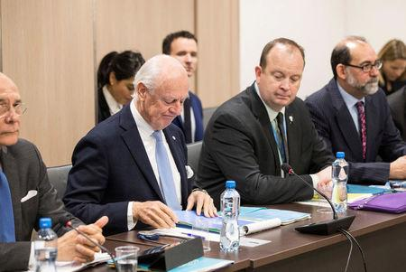 United Nations Special Envoy for Syria Staffan de Mistura attends a round of negotiations with the delegation of the Syrian Negotiation Commission (SNC) during the Intra Syria talks, at the European headquarters of the U.N. in Geneva, Switzerland December 14, 2017. REUTERS/Xu Jinquan/Pool