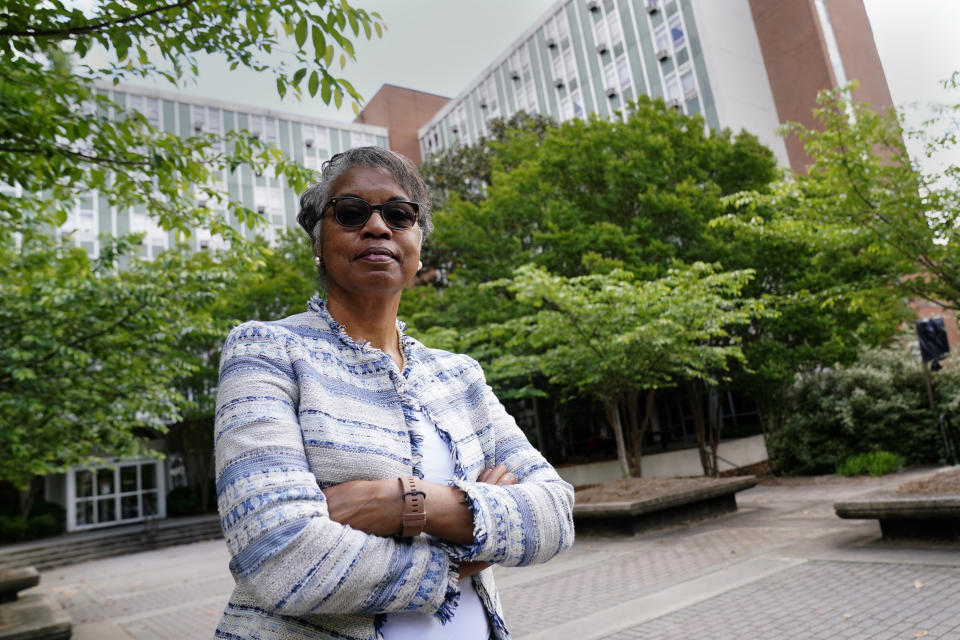 """Hattie Whitehead Thomas poses for a portrait on the campus of the University of Georgia in Athens, Ga., on Thursday, May 6, 2021, where a Black neighborhood was razed in the 1960's to make room for dorms. The 72-year-old Athens resident grew up in the destroyed Linnentown neighborhood. """"UGA has got to do more. It's got to come to the table and acknowledge what it did,"""" she says. (AP Photo/John Bazemore)"""