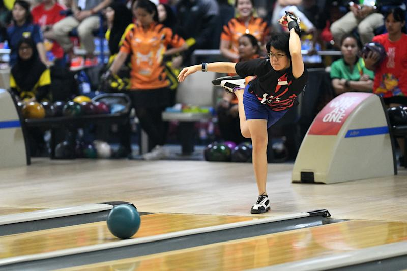 Singapore bowler Cherie Tan in action in the women's team competition at the SEA Games. (PHOTO: SNOC/Lim Weixiang)