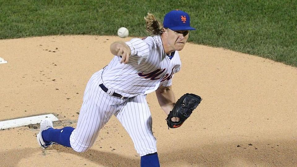 Noah Syndergaard fires a pitch, unique view above mound