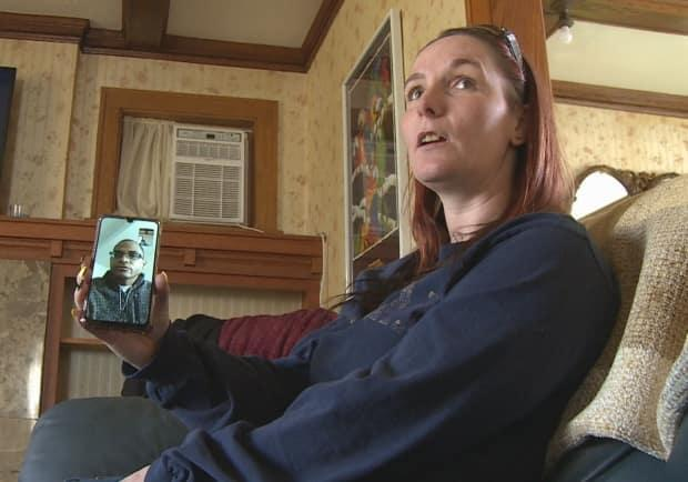 It's been a difficult year for Tina Ouellette and her partner James Washington, as they've only been able to communicate by video chat. (Jacob Barker/CBC - image credit)