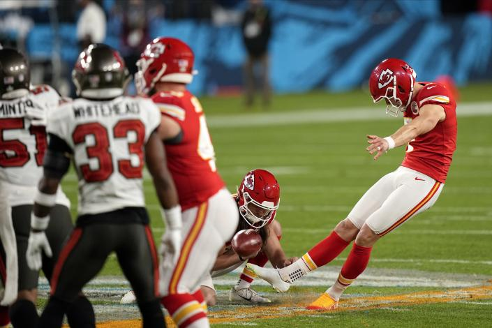 Kansas City Chiefs kicker Harrison Butker (7) kicks a field goal against the Tampa Bay Buccaneers during the first half of the NFL Super Bowl 55 football game Sunday, Feb. 7, 2021, in Tampa, Fla. (AP Photo/David J. Phillip)
