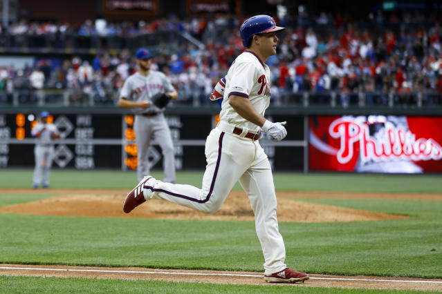 Philadelphia Phillies' Scott Kingery, right, rounds the bases past New York Mets starting pitcher Zack Wheeler after hitting a home run during the fifth inning of a baseball game, Wednesday, April 17, 2019, in Philadelphia. Philadelphia won 3-2. (AP Photo/Matt Rourke)