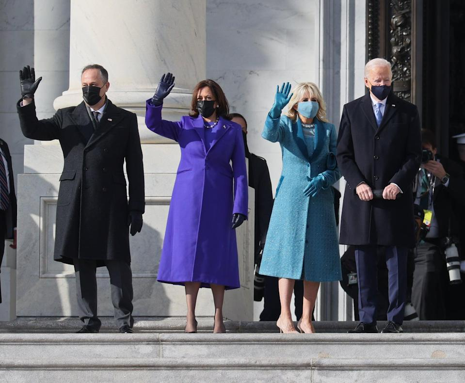 WASHINGTON, DC - JANUARY 20: (EDITOR'S NOTE: Alternate crop) (L-R) Doug Emhoff, U.S. Vice President-elect Kamala Harris, Jill Biden and President-elect Joe Biden wave as they arrive on the East Front of the U.S. Capitol for  the inauguration on January 20, 2021 in Washington, DC.  During today's inauguration ceremony Joe Biden becomes the 46th president of the United States. (Photo by Joe Raedle/Getty Images)