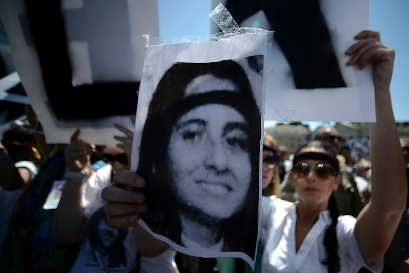 Posters of Emanuela Orlandi are often held up by people demonstrating over the case (AFP Photo/FILIPPO MONTEFORTE)