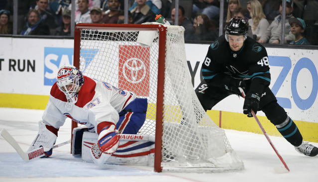 San Jose Sharks' Tomas Hertl, right, moves the puck behind Montreal Canadiens goalie Antti Niemi during the first period of an NHL hockey game Thursday, March 7, 2019, in San Jose, Calif. (AP Photo/Ben Margot)